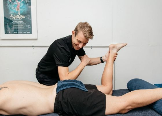 A client receiving massage therapy treatment