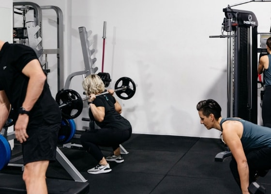 Clients working out in a group session class